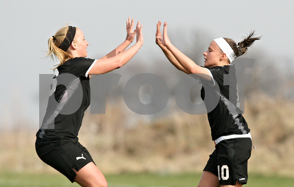 Rob Winner – rwinner@daily-chronicle.com<br /> <br /> Sycamore's Lindsey Hemmerich (left) congratulates Michelle Doran after her first of two goals during the first half in Maple Park, Ill., on Wednesday, April 6, 2011. Sycamore defeated Kaneland, 4-1.