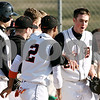 Rob Winner – rwinner@daily-chronicle.com<br /> <br /> DeKalb's Brian Sisler is greeted by his teammates at home plate after a grand slam in the second inning on Wednesday, March 30, 2011 in DeKalb, Ill. Huntley defeated DeKalb, 11-8.