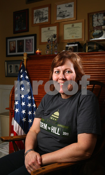 Kyle Bursaw – kbursaw@daily-chronicle.com<br /> <br /> Veteran and commander of the Sycamore VFW Laurie Emmer recently spoke to members of Congress about veterans' issues like unemployment and suicide. Pictured here in her den in Sycamore, Ill. on Friday, April 22, 2011.
