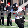 Kyle Bursaw – kbursaw@daily-chronicle.com<br /> <br /> Tailback Cameron Bell makes his way upfield on a play fake during practice at Huskie Stadium on Thursday, March 24, 2011.