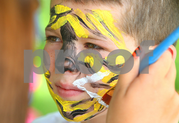 Kyle Bursaw – kbursaw@daily-chronicle.com<br /> <br /> Cole Ewers has a tiger pattern painted on his face during the Shabbona Fourth of July Festival on Saturday, July 2, 2011.