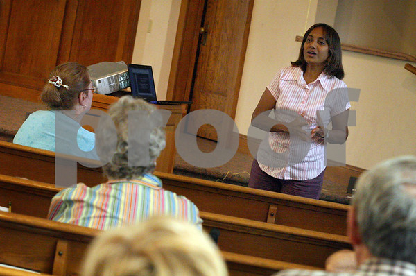 Wendy Kemp - For The Daily Chronicle<br /> <br /> Sarah Chetti, an American Baptist missionary (right), talks about her ministry in Lebanon at First Baptist Church in DeKalb on Wednesday.<br /> DeKalb 7/6/11