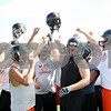 Rob Winner – rwinner@daily-chronicle.com<br /> <br /> The offensive linesmen of the DeKalb football team finish a drill during the first day of practice on Wednesday, Aug. 10, 2011.