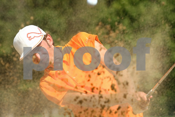Kyle Bursaw – kbursaw@shawmedia.com<br /> <br /> DeKalb senior Mason Struthers hits out of the sand trap during practice at Kishwaukee Country Club on Thursday, Sept. 1, 2011.