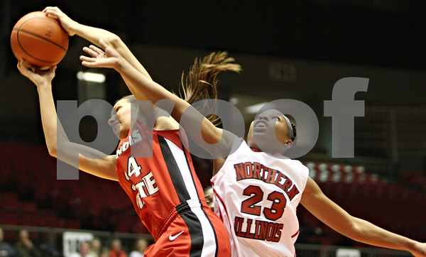 Rob Winner – rwinner@daily-chronicle.com<br /> <br /> Illinois State guard Hannah Spanich controls a rebound after a shot by Northern Illinois guard Marke Freeman (23) during the first half in DeKalb, Ill. on Monday, Jan. 3, 2011.