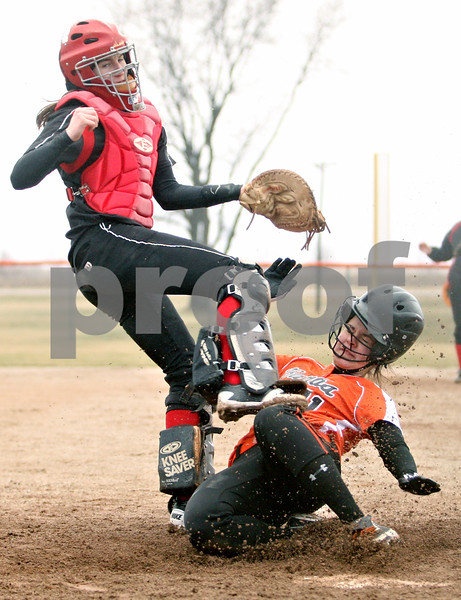 Rob Winner – rwinner@daily-chronicle.com<br /> <br /> Unable to step on the plate for the force out, Indian Creek catcher Anna Stiker tags out DeKalb's Sabrina Killeen during the bottom of the third inning. DeKalb went on to defeat Indian Creek in five innings, 16-4.
