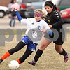 Kyle Bursaw – kbursaw@daily-chronicle.com<br /> <br /> Genoa-Kingston's Rachael Ellstrom  passes the ball while being guarded by Harvard's Ingrid Rendon in the first half of the game at Genoa-Kingston high school on Tuesday, April 5, 2011.