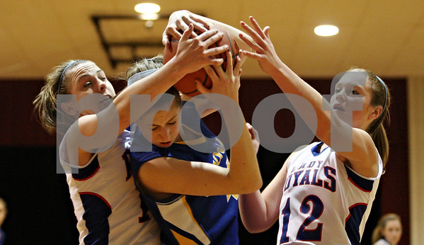 Rob Winner – rwinner@daily-chronicle.com<br /> <br /> Hinckley-Big Rock's Kaitlin Phillips (left to right), Somonauk's Allison Humes and Hinckley-Big Rock's Katie Hollis battle for possession of a rebound under the Lady Royals' basket during the third quarter in Shabbona, Ill. on Thursday, January 20, 2011.