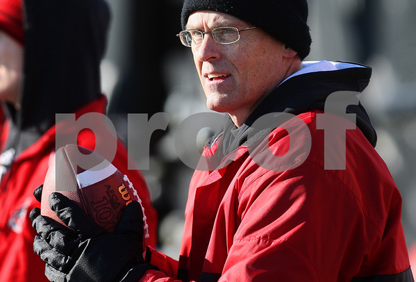 Kyle Bursaw – kbursaw@daily-chronicle.com<br /> <br /> Defensive coordinator Jay Niemann looks on during practice at Huskie Stadium on Thursday, March 24, 2011.