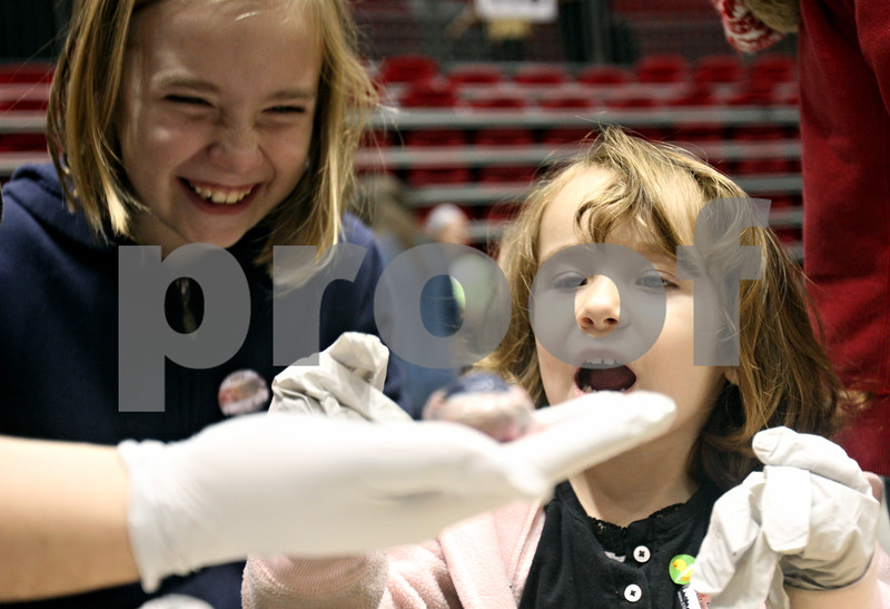 Rob Winner – rwinner@shawmedia.com<br /> <br /> (From left) Sisters Kiera Collier, 8, and Raven Collier, 3, examine a cow eyeball during a demonstration at STEMfest at the Convocation Center at Northern Illinois University in DeKalb on Saturday, Oct. 22, 2011. STEMfest seeks to increase public awareness of science, technology, engineering, and math (STEM) initiatives, activities, careers, and education for the people of northern Illinois.