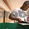 Kyle Bursaw – kbursaw@daily-chronicle.com<br /> <br /> Darvelle Gunn sorts through some of his locker contents next to the trash bin during a designated locker clean out at DeKalb High School on Wednesday, May 25, 2011.