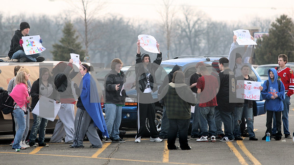 Kyle Bursaw – kbursaw@daily-chronicle.com<br /> <br /> About two dozen Genoa-Kingston high school students walked out of school to protest teachers being dismissed due to budget issues in the school's parking lot on the morning of Tuesday, March 15, 2011.