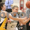 Kyle Bursaw – kbursaw@daily-chronicle.com<br /> <br /> Sycamore's Kelcee Miller (25) loses a ball out of bounds to the defense of Sterling's Steph Echebarria (30) in the first half of the game between Sycamore and Sterling at Sycamore high school on Tuesday, Jan. 4, 2011.