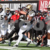 Rob Winner – rwinner@shawmedia.com<br /> <br /> Northern Illinois center Scott Wedige (71) tackles Western Michigan safety Doug Wiggins (1) after an interception thrown by Chandler Harnish during the first quarter in DeKalb, Ill., on Saturday, Oct. 15, 2011. Northern Illinois defeated Western Michigan, 51-22.