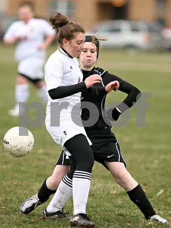 Rob Winner – rwinner@daily-chronicle.com<br /> <br /> Indian Creek's Alexandria Corniveau (1) and Kaneland's Brittany Olson (right) try to control a ball during the first half on Monday, April 4, 2011, in Waterman, Ill. Kaneland defeated Indian Creek, 5-0.
