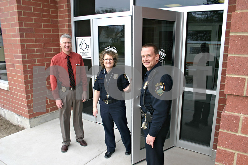 Detective Steve Cook, Administrative Secretary Colleen Ziegler and Lt. Darrell Johnson, all of the Sycamore Police Department, welcomed the public to the department's new office, which opened Tuesday.