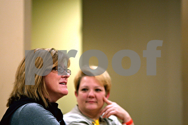 """Rob Winner – rwinner@shawmedia.com<br /> <br /> Angela Montgomery (left) explains a time she was put in an uncomfortable situation as Thelma Holderness listens during a safety seminar that was held at the DeKalb Elks 765 Lodge in honor of Antinette """"Toni"""" Keller on Tuesday night."""