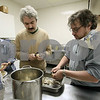 Wendy Kemp - For The Daily Chronicle<br /> Liz Blau, Ilya Krishtal and Alex Gelman (l to r) peel potatoes for the party at Congregation Beth Shalom on Sunday in DeKalb.<br /> DeKalb 12/18/11
