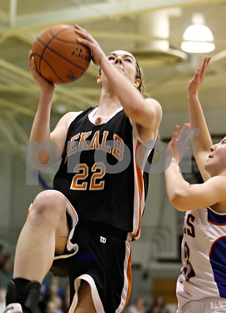 Rob Winner – rwinner@daily-chronicle.com<br /> <br /> DeKalb's Emily Bemis puts up two during the second quarter.