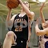 Rob Winner – rwinner@daily-chronicle.com<br /> <br /> DeKalb's Emily Bemis puts up two during the second quarter.