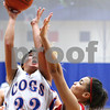 Kyle Bursaw – kbursaw@shawmedia.com<br /> <br /> Genoa-Kingston's Rachel Ellstrom puts up a shot with a Mooseheart player defending in the third quarter of their game in Genoa, Ill. on Wednesday, Dec. 14, 2011.