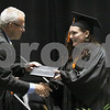 Wendy Kemp - For The Daily Chronicle<br /> <br /> Graduate Alexandra Anderson accepts her diploma during the DeKalb High School graduation ceremony at the Convocation Center at Northern Illinois University on Saturday.