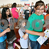 Rob Winner – rwinner@daily-chronicle.com<br /> <br /> Fifth grader Morgan Challand (right) stands still as third grader Sydney McNett signs the back of Challand's shirt as students gathered in the gymnasium at Malta Elementary School to sign yearbooks during the last day of school on Monday morning.