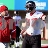 Kyle Bursaw – kbursaw@daily-chronicle.com<br /> <br /> Assistant coach Eddie Faulkner talks with Jason Schepler (87) during practice at Huskie Stadium on Thursday, March 24, 2011.