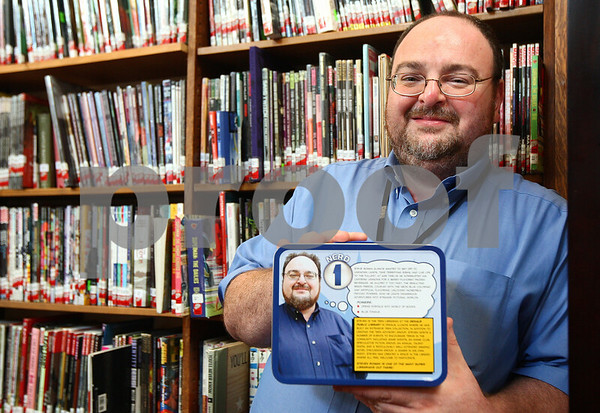 """Kyle Bursaw – kbursaw@shawmedia.com<br /> <br /> Steven Roman, of the DeKalb Public Library, recently won an award naming him a """"Superhero Librarian."""" Roman was one of four librarians nationwide to win this award, and he was given a custom lunch box with a superhero  version of himself on it.<br /> <br /> Friday, Sept. 2, 2011."""