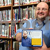 "Kyle Bursaw – kbursaw@shawmedia.com<br /> <br /> Steven Roman, of the DeKalb Public Library, recently won an award naming him a ""Superhero Librarian."" Roman was one of four librarians nationwide to win this award, and he was given a custom lunch box with a superhero  version of himself on it.<br /> <br /> Friday, Sept. 2, 2011."