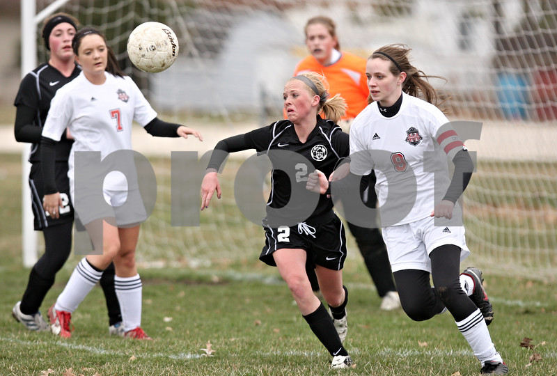 Rob Winner – rwinner@daily-chronicle.com<br /> <br /> Kaneland's Taylor White (2) and Indian Creek's Cameron Wallace (9) chase after a ball during the first half on Monday, April 4, 2011, in Waterman, Ill. Kaneland defeated Indian Creek, 5-0.