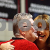 Kyle Bursaw – kbursaw@shawmedia.com<br /> <br /> State Senator Christine Johnson (right) embraces Grace Catron after recognizing her as Shabbona Lake State Park's 12 millionth visitor during a ceremony celebrating the park at Indian Creek High School on Monday, Dec. 12, 2011.