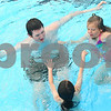 Kyle Bursaw – kbursaw@daily-chronicle.com<br /> <br /> Jacob Collingbourne (clockwise from left), Betsy Benisek and Tori Navarro play a game of Marco Polo in the Hopkins Park Pool in DeKalb, Ill. on Wednesday, June 15, 2011. The three are in Camp Maple Leaf.