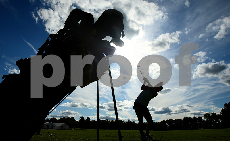 Kyle Bursaw – kbursaw@daily-chronicle.com<br /> <br /> Hinckley-Big Rock's Brittany Herrmann works on her long game at the range during practice at Indian Oaks Golf Course on Wednesday, Aug. 10, 2011.