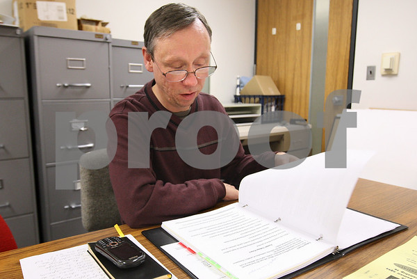 Kyle Bursaw – kbursaw@daily-chronicle.com<br /> <br /> Joe Dubowski tries to decide on a research topic as he pages through his notes in Wiritz Hall at Northern Illinois University where he is a student.<br /> <br /> Wednesday, Feb. 9, 2011.