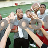 Rob Winner – rwinner@daily-chronicle.com<br /> <br /> Northern Illinois football players including Tommy Davis (from left to right), Nathan Palmer and Rashaan Melvin help teach a group of women about receiving and defending the pass during the third annual Football 101 Women's Clinic at the Yordon Center in DeKalb on Wednesday night.