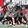 Rob Winner – rwinner@shawmedia.com<br /> <br /> Northern Illinois linebackers Jamaal Bass (6), Pat Schiller (53) and defensive end Alan Baxter (90) tackle Western Michigan tight end Clark Mussman (45) after a gain of five yards during the fourth quarter in DeKalb, Ill., on Saturday, Oct. 15, 2011. Northern Illinois defeated Western Michigan, 51-22.