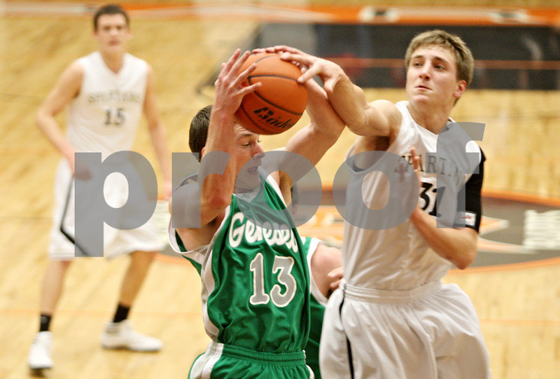 Rob Winner – rwinner@shawmedia.com<br /> <br /> Geneseo guard Luke Snyder (13) controls a rebound ahead of Sycamore forward Tom Paulson (31) under the Spartans' basket during the third quarter in DeKalb, Ill., at the Chuck Dayton Tournament on Wednesday, Dec. 28, 2011. Geneseo defeated Sycamore, 31-26.