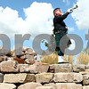 Kyle Bursaw – kbursaw@shawmedia.com<br /> <br /> Gene Vanden Bosch, of DeKalb Fire's Highland Honor Guard, plays the bugle while standing on rocks in the healing garden of Kishwaukee Community Hospital near the end of a Sept 11 memorial ceremony on Sunday, Sept. 11, 2011.