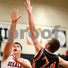 Kyle Bursaw – kbursaw@shawmedia.com<br /> <br /> DeKalb center Jake Smith puts up a shot  as Winnebago's Ryan Swigart defends during the second half of the game in the Chuck Dayton Holiday Tournament in DeKalb, Ill. on Thursday, Dec. 22, 2011. DeKalb defeated Winnebago 46-36.