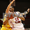 Rob Winner – rwinner@shawmedia.com<br /> <br /> Northern Illinois' Kevin Gray (13) drives to the basket as Valparaiso's Ryan Broekhoff defends during the first half on Tuesday, Dec. 20, 2011, in DeKalb, Ill.