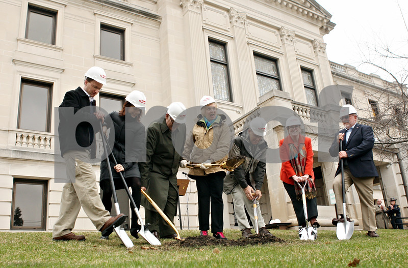 Rob Winner – rwinner@daily-chronicle.com<br /> <br /> DeKalb county officials use shovels to break ground as a ceremony for the DeKalb County Courthouse was held on Monday morning in Sycamore.