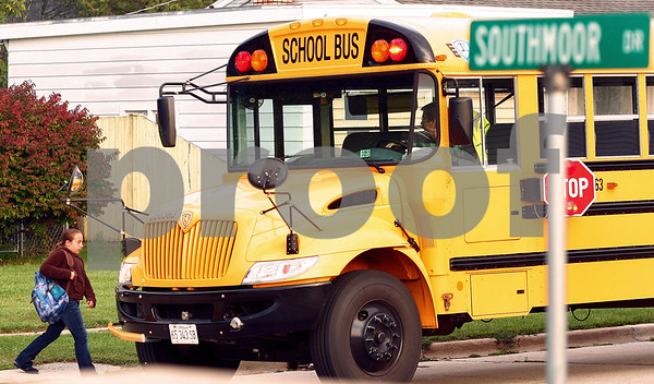 Kyle Bursaw – kbursaw@shawmedia.com<br /> <br /> A student boards one of District 428's buses on the morning of Thursday, Sept. 29, 2011.