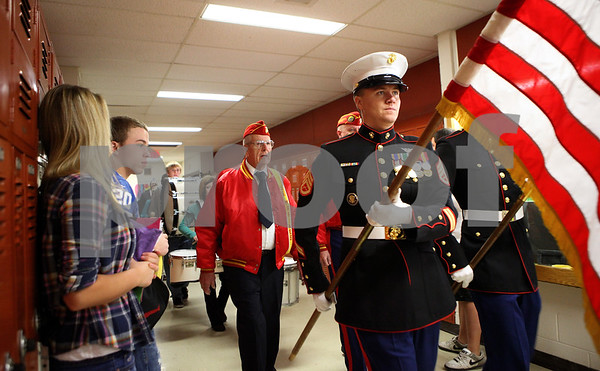 Kyle Bursaw – kbursaw@shawmedia.com<br /> <br /> Staff Sergeant Chase Kovarik (holding U.S. flag), leads a parade of veterans through the halls of Sycamore High School on Friday, Nov. 11, 2011.