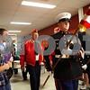 Kyle Bursaw – kbursaw@shawmedia.com<br /> <br /> Staff Sergeant Chase Kovarik (holding U.S. flag), leads a parade of veterans through the halls of Sycamore High School on Friday, Nov. 11, 2011.