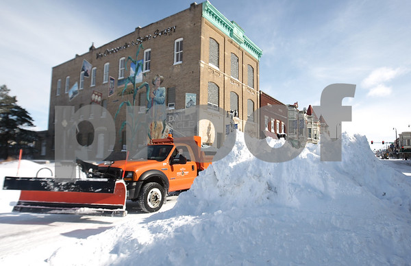 Kyle Bursaw – kbursaw@daily-chronicle.com<br /> <br /> A plow drives past a mound of snow in the middle of Lincoln Highway near where it intersects with First Street on Wednesday, Feb. 2, 2011.