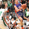 Kyle Bursaw – kbursaw@daily-chronicle.com<br /> <br /> Genoa-Kingston's Bret Lucca goes up for a shot during the first quarter. The Genoa-Kingston Cogs defeated the Rock Falls Rockets 62-49 in Genoa, Ill. on Tuesday, March 1, 2011.