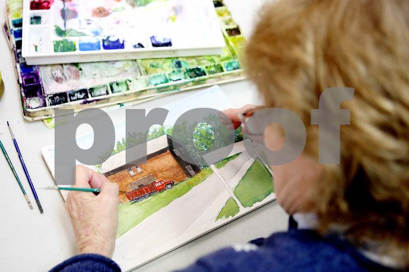 Rob Winner – rwinner@daily-chronicle.com<br /> <br /> Joan McEachern, of Yorkville, works on a watercolor painting at the Fox Valley Community Center in Sandwich on Thursday afternoon.