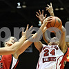 Rob Winner – rwinner@daily-chronicle.com<br /> <br /> Northern Illinois forward Kim Davis tries to control her own rebound during the first half in DeKalb, Ill. on Wednesday, Jan. 19, 2011.