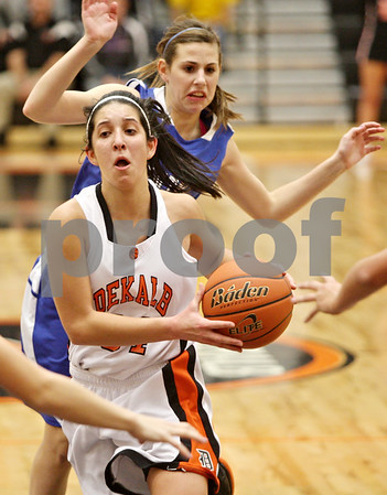 Rob Winner – rwinner@shawmedia.com<br /> <br /> DeKalb's Rachel Torres goes to the basket for two points during the second quarter in DeKalb, Ill., on Tuesday, Dec. 6, 2011.